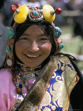 Young Woman Wearing Typical Amber Jewellery, Yushu Horse Fair, Qinghai Province, China by Occidor Ltd