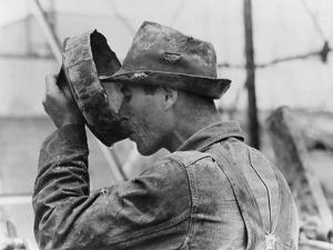 Oil Field Worker Drinking Water from a Crude Metal Container, Kilgore, Texas, 1939