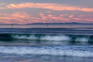 Oil rigs and waves in the Pacific Ocean, Channel Islands of California, Carpinteria, Santa Barba...