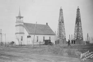 Oil Well Construction behind Church
