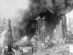 Oil Wells Spouting Streams of Fire