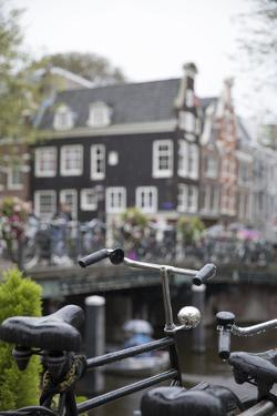 The Netherlands, Holland, Amsterdam, bicycle in canal by olbor