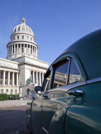 https://imgc.allpostersimages.com/img/posters/old-american-car-parked-near-the-capitolio-building-havana-cuba-west-indies-central-america_u-L-PFNW1F0.jpg?p=0