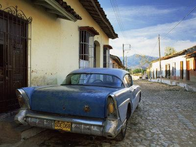 https://imgc.allpostersimages.com/img/posters/old-american-car-parked-on-cobbled-street-trinidad-cuba-west-indies-central-america_u-L-P7NKIO0.jpg?artPerspective=n