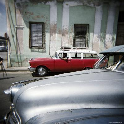 https://imgc.allpostersimages.com/img/posters/old-american-cars-operating-as-private-taxis-havana-cuba-west-indies-central-america_u-L-P2QT1J0.jpg?p=0