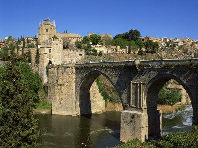 https://imgc.allpostersimages.com/img/posters/old-gateway-bridge-over-the-river-and-the-city-of-toledo-castilla-la-mancha-spain-europe_u-L-P7MO000.jpg?p=0