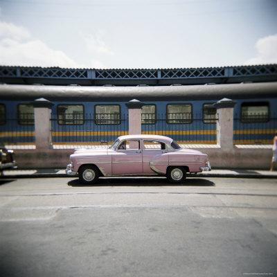 https://imgc.allpostersimages.com/img/posters/old-pink-american-car-outside-railway-station-havana-cuba-west-indies-central-america_u-L-P2QSY10.jpg?p=0