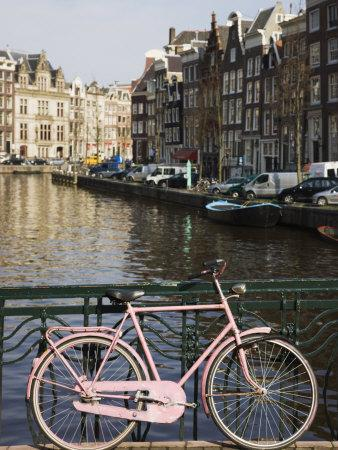 https://imgc.allpostersimages.com/img/posters/old-pink-bicycle-by-the-herengracht-canal-amsterdam-netherlands-europe_u-L-P7O3740.jpg?p=0