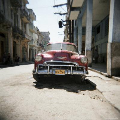 https://imgc.allpostersimages.com/img/posters/old-red-american-car-havana-cuba-west-indies-central-america_u-L-P2QSPV0.jpg?p=0