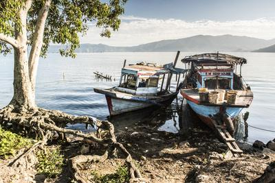 https://imgc.allpostersimages.com/img/posters/old-rusty-fishing-boats-in-a-village-at-lake-toba-danau-toba-north-sumatra-indonesia_u-L-Q12SD520.jpg?p=0