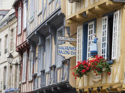 https://imgc.allpostersimages.com/img/posters/old-timber-framed-buildings-in-quimper-southern-finistere-brittany-france_u-L-P1K3DB0.jpg?artPerspective=n