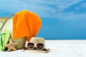 Summer Beach Bag with Coral,Towel and Flip Flops on Sandy Beach by oleggawriloff