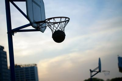 Hoops Basketball Game on the Streets Ring with a Net by olegmalyshev