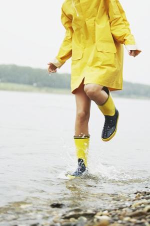 Woman Splashing in Lake