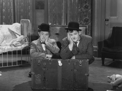 https://imgc.allpostersimages.com/img/posters/oliver-hardy-stan-laurel-pack-up-your-troubles-1932_u-L-Q10T9DM0.jpg?artPerspective=n