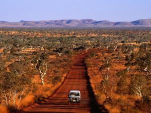 Car on Outback Road, Karijini National Park, Australia by Oliver Strewe