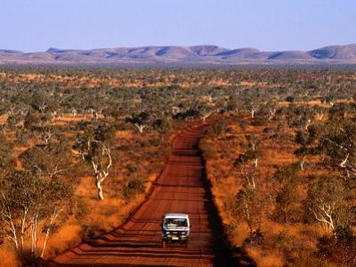 Car on Outback Road, Karijini National Park, Australia by Oliver Strewe