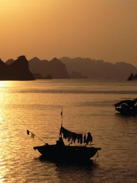 Dusk Over Halong Bay, Halong City, Vietnam by Oliver Strewe