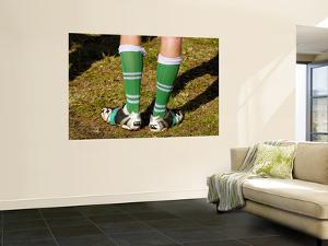 Football Boots with Legs in Them by Oliver Strewe