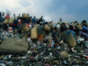 People Searching Through Rubbish in Manila's Smoky Mountain, Manila, Philippines by Oliver Strewe