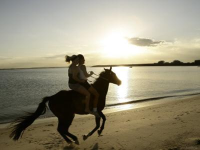 Two Girls Horseriding along Beach at Yarra Bay, Botany Bay, Sydney, New South Wales, Australia by Oliver Strewe