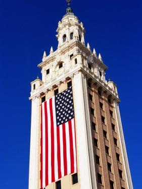 Us Flag Hanging From Building, Miami, U.S.A. by Oliver Strewe
