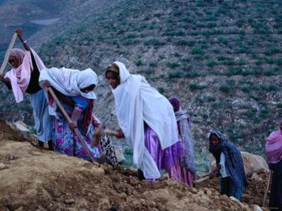 Women Repairing Road on Hillside, Eritrea by Oliver Strewe