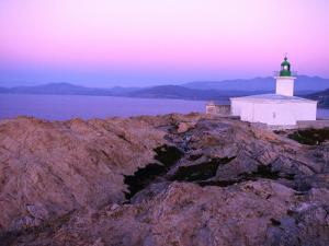 La Pietra Lighthouse, Ile Rousse, Corsica, France by Olivier Cirendini