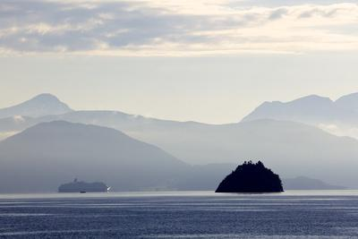 A Hurtigruten Cruise Boat in the Fjords of Norway, Scandinavia, Europe