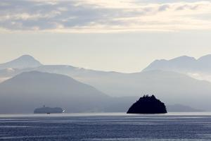 A Hurtigruten Cruise Boat in the Fjords of Norway, Scandinavia, Europe by Olivier Goujon
