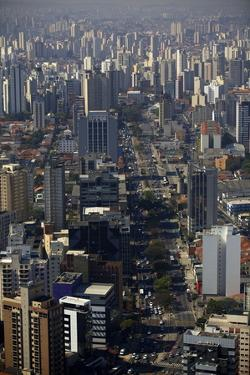 View over Sao Paulo Skyscrapers and Traffic Jam from Taxi Helicopter by Olivier Goujon