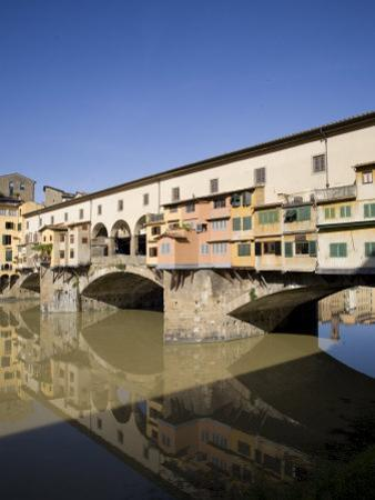 Reflection in the Arno River of the Ponte Vecchio, Florence, Tuscany, Italy, Europe