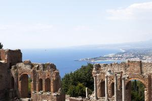 View over the Naxos Coast from the Greek Roman Theatre of Taormina, Sicily, Italy, Europe by Oliviero Olivieri