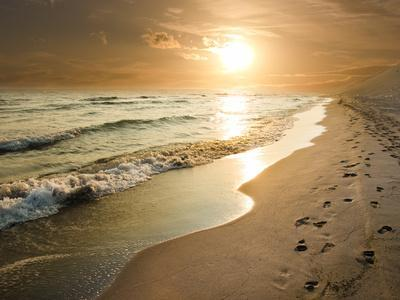 Golden Sunset on the Sea Shore and Footprints in the Sand