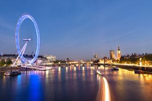 London Eye and Big Ben on the Banks of Thames River at Twilight by ollirg