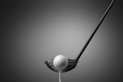 Detail Of A Golf Club And Ball