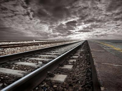 Empty Railway Tracks In A Stormy Landscape