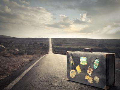 Vintage Suitcase on a Deserted Road