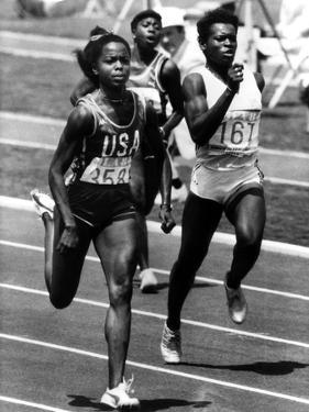 Olympic Games in Los Angeles, 1984 : American Evelyn Ashford Winning the 100M, on R : Heather Oaks