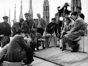 """On the set of film """"Rocco and his Brothers"""" , Luchino Visconti directs Annie Girardot and Alain Del"""