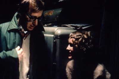 https://imgc.allpostersimages.com/img/posters/on-the-set-woody-allen-directs-mia-farrow-purple-rose-of-cairo-1985-directed-by-wood-y-allen-ph_u-L-Q1C3LVY0.jpg?artPerspective=n