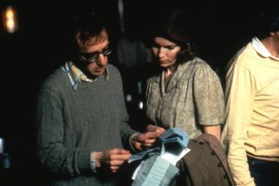 https://imgc.allpostersimages.com/img/posters/on-the-set-woody-allen-directs-mia-farrow-purple-rose-of-cairo-1985-directed-by-wood-y-allen-ph_u-L-Q1C3M160.jpg?artPerspective=n