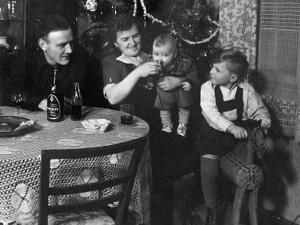 One Year Old Baby Boy Gets a Drink of Coca Cola in Front of the Christmas Tree, Ca. 1946