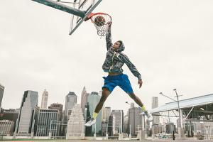 Basketball Player Performing Slum Dunk on a Street Court. Background with Manhattan Buildings by Oneinchpunch