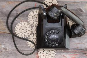 Old Rotary Telephone with the Handset off the Hook by oocoskun