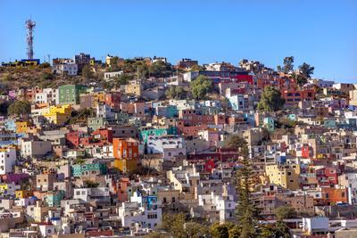 https://imgc.allpostersimages.com/img/posters/orange-blue-red-houses-of-guanajuato-mexico_u-L-Q1D0KSC0.jpg?p=0