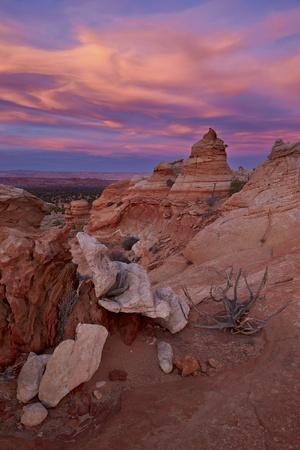 https://imgc.allpostersimages.com/img/posters/orange-clouds-at-sunset-over-sandstone-cones_u-L-PWFKAF0.jpg?p=0