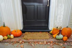 Pumpkins on Front Steps of Home during Halloween/Thanksgiving Season by Orhan