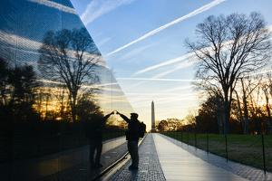 Washington DC - A Veteran Looks for a Name at Vietnam Veterans Memorial Wall at Sunrise by Orhan
