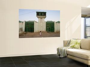 Girl with Traditional Somali Residential Water Storage Tank Above Her by Orien Harvey